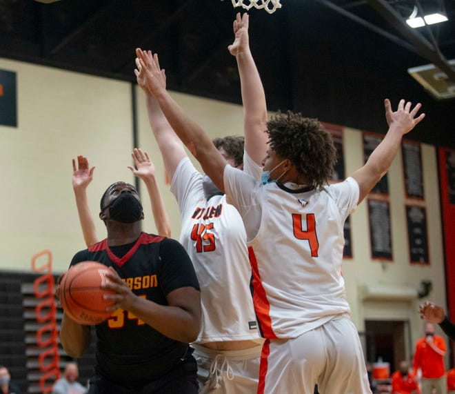 Jefferson's Antonio Leavy looks up through the arms of Harlem defenders on Tuesday, March 9, 2021, at Harlem High School in Machesney Park. Leavy struggled to score against the Huskies' stifling defense. Harlem won the game 53-47 and will play East for the NIC-10 championship.