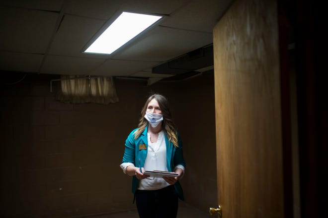 Dani Powers, a Realtor with Dickerson & Nieman Realtors, conducts a final walk through in the basement of a brick ranch home in the city's Rolling Green neighborhood Wednesday, March 10, 2021, in Rockford, on behalf of the buyer before the sale closes on Friday.