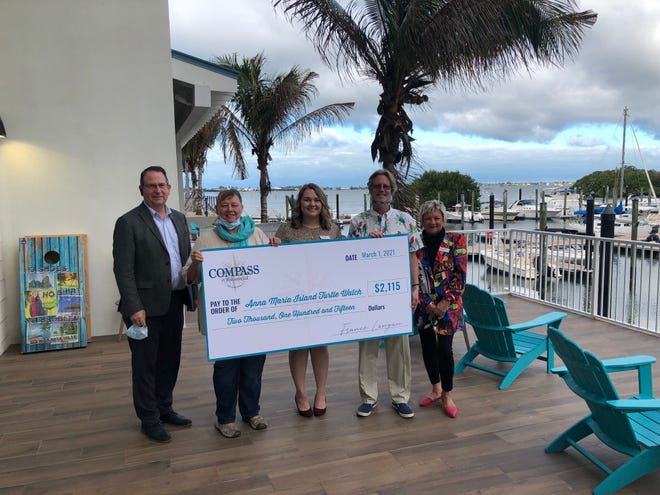 Holding the donation check are:Michael Gulotty, senior vice president of operations, Vista Host Hotel Development and Management; Suzi Fox, director, Anna Maria Island Turtle Watch; Arielle Tatum, director of sales, Compass by Margaritaville, Anna Maria Sound; France Langan, general manager, Compass by Margaritaville, Anna Maria Sound; and Susanne Arbanas, director of Contagious Enthusiasm, Compass by Margaritaville, Anna Maria Sound.