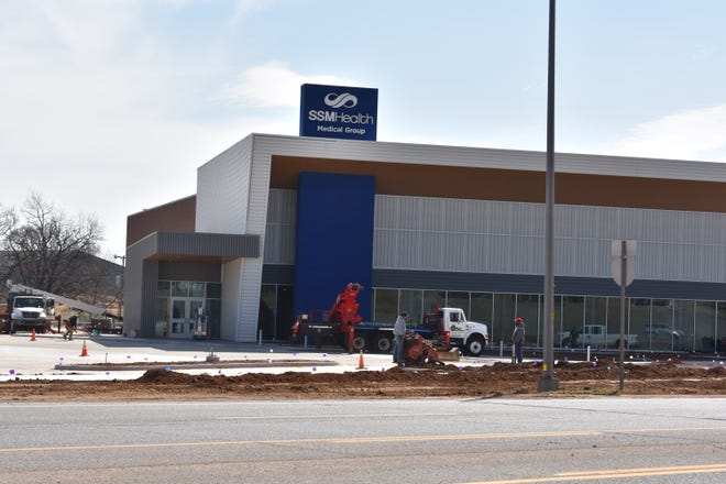 The sign has been placed on SSM Health Medical Group's new building at Domino Plaza.