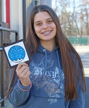 Etna high freshman Ava Padgett holds the patch she designed, which was selected as the 2021 City of Etna Travel Patch. The patch is purchased by Pacific Crest Trail hikers who may stop in the small town to rest, get mail, and refuel for their long journey ahead.