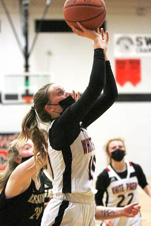 Ashley Delayre scores two points for White Pigeon against Decatur on Tuesday night.