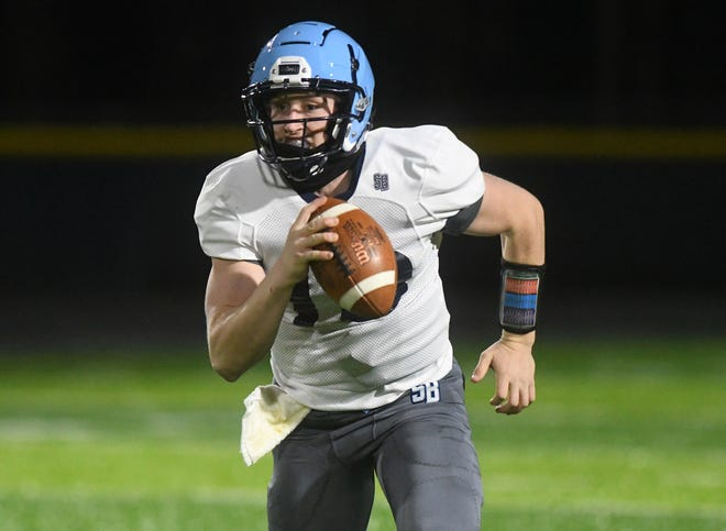 South Brunswick quarterback Roman Dilgard runs at North Brunswick in Leland, N.C., Tuesday, March 9, 2020. This was the season opener for both teams after COVID delays.   [MATT BORN/STARNEWS]