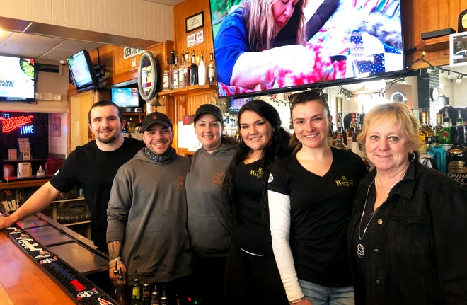 At The Royal, from left, Will Fuller, Brent Clark, Amiee Clark, Sadie Fuller, Jill Milch and Laura Dickson. The longstanding Middleboro bar is under new management and now offering a food menu in cooperation with Clark's Catering.