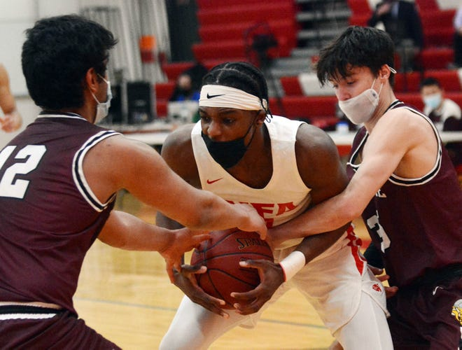 NFA'S Max Pierre Louis battles for a loose ball with East Lyme's Sujesh Kurumbail, left, and Marshall Gada Tuesday during NFA's 45-33 win in Norwich.