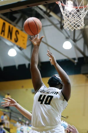 Topeka High junior NiJaree Canady sinks a layup in the first quarter of Tuesday's game against Wichita Heights. The Trojans won 71-36.