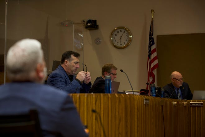 Topeka City Council member Spencer Duncan, right, said he is torn on changing residency requirements.