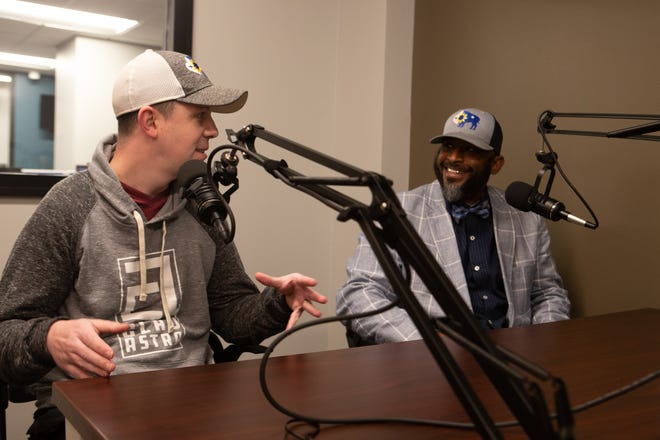 "Thad Lockard, left, and S.J. Hazim, right, own Clad Astra, a local apparel company specializing in gear that helps Topekans display their community pride. The pair recently sat down with Capital-Journal reporter India Yarborough for an episode of ""It's Your Business,"" the paper's premier business podcast."