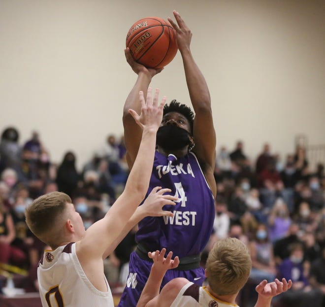 Topeka West's Elijah Brooks shoots a contested jumper during Tuesday's 52-49 state quarterfinal win at Hays.