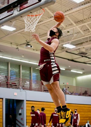 Worcester Academy's Kayvaun Mulready delivers a dunk during a recent practice.