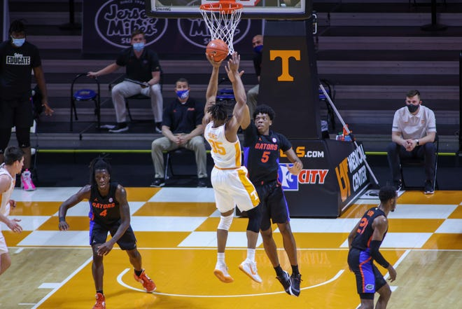 Florida had trouble playing defense in the second half of its game last Sunday at Tennessee. Volunteers guard Yves Pons (35) shoots the ball against Florida forward Omar Payne at Thompson-Boling Arena. The Gators lost 65-54, their second consecutive setback to end the regular season.