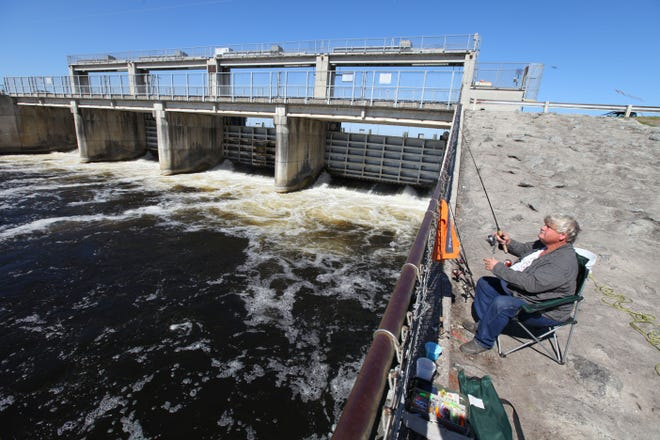 A man waits for fish to take the bait just below the Kirkpatrick Dam at the Rodman Reservoir recreation area in this file photo. A new report warns that the Rodman Dam is in serious disrepair. [FILE]