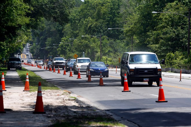 Construction is shown on a redesign of Northwest Eighth Avenue just east of Northwest 34th Street in Gainesville in 2016.