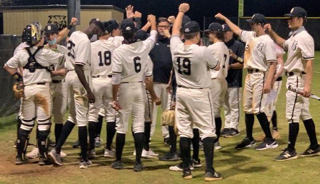 Buchholz's baseball team celebrates another win.