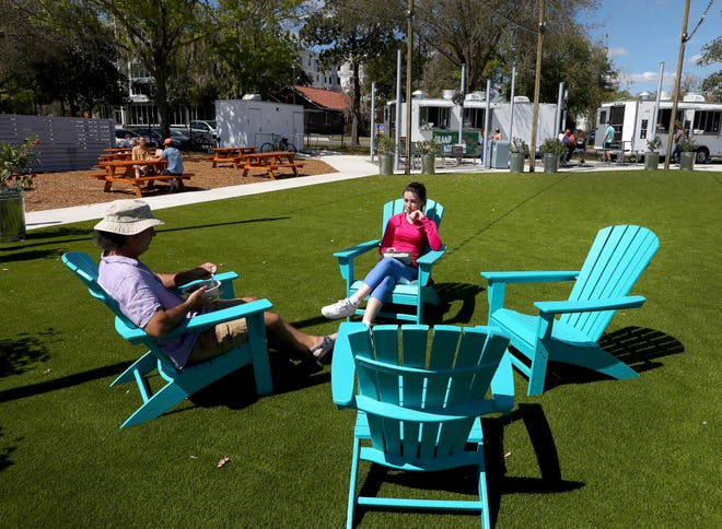 People enjoy some food on Wednesday at the new Midpoint Park & Eatery, 931 SW Second Ave., in the Innovation Hub area of Gainesville.