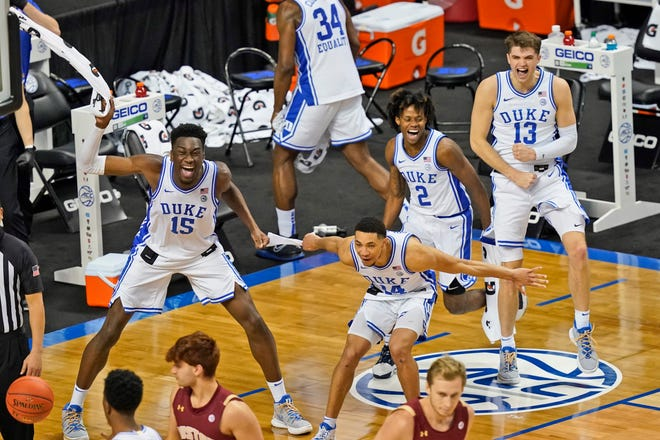 From left, Duke's Mark Williams, Jordan Goldwire, DJ Steward and Joey Baker cheer on teammates during a rout of Boston College on Tuesday in the first round of the ACC Tournament.
