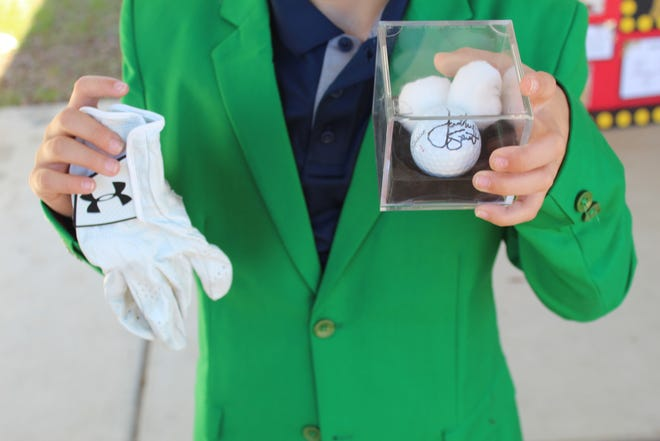 Professional golfer Jordan Spieth gave a glove and a signed ball to Southport Elementary student James Anderson to help him with a recent school project about the golfer's life.