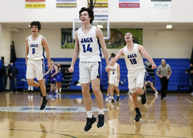 Jeb Bischoff (14), Cade Norris (5) and Peyton Murphy (15) celebrate Bradley's 46-37 win over visiting Pickerington Central in a Division I district final March 6. The Jaguars won their second consecutive district title andthirdin four seasons.