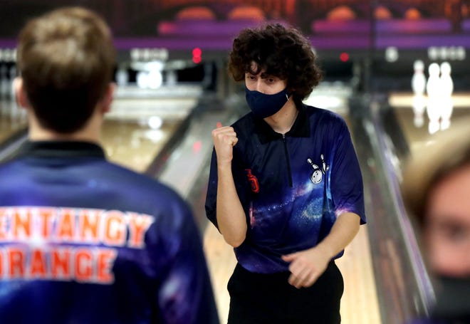 Orange freshman Bobby Drexel reacts after rolling a strike during the Division I state tournament March 6 at Wayne Webb's Columbus Bowl. The Pioneers finished 15th.