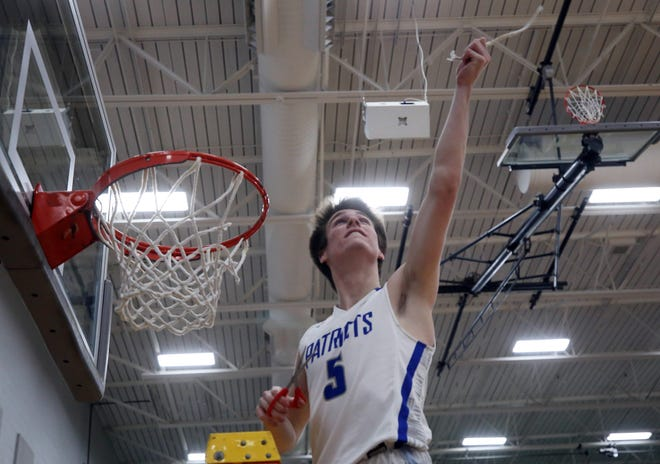 Liberty's Ty Foster celebrates following the Patriots' 57-45 win over visiting Newark in a Division I district final March 6. It was the third district title in program history.