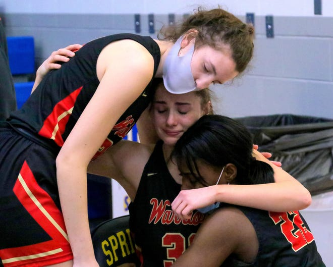 Worthington Christian's Katherine Weakley (center) is embraced by teammates Anna  Schwartz (left) and Izzie Slaughter after the Warriors lost 39-36 to Cincinnati Purcell Marian in a Division III regional final March 6 at Springfield.