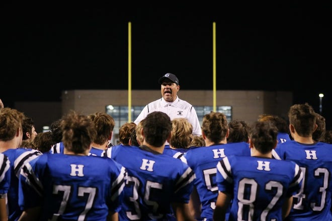 Former Hilliard Davidson coach Brian White talks with his team after a game in 2019. White is part of the 2021 class for the Central District Football Coaches Association Hall of Fame.