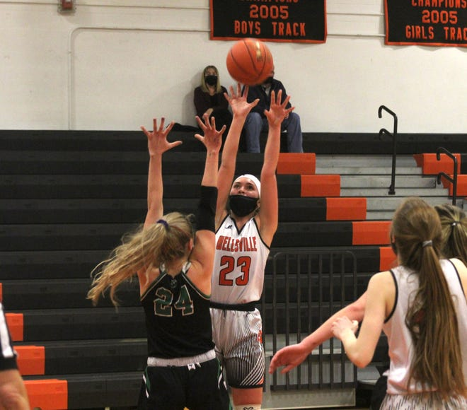 Wellsville's Kaylee Coleman (23) puts up a shot over the North Rose-Wolcott defense Tuesday night.