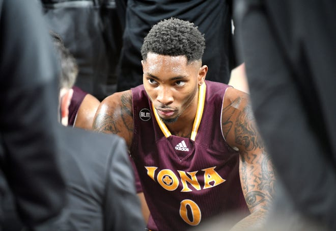 Iona's Berrick Jeanlouis listens to coach Rick Pitino during Tuesday's MAAC Men's Basketball Tournament matchup against Quinnipiac. The Gaels topped Quinnipiac, 72-48, at Boardwalk Hall in Atlantic City on Mar. 9, 2021.