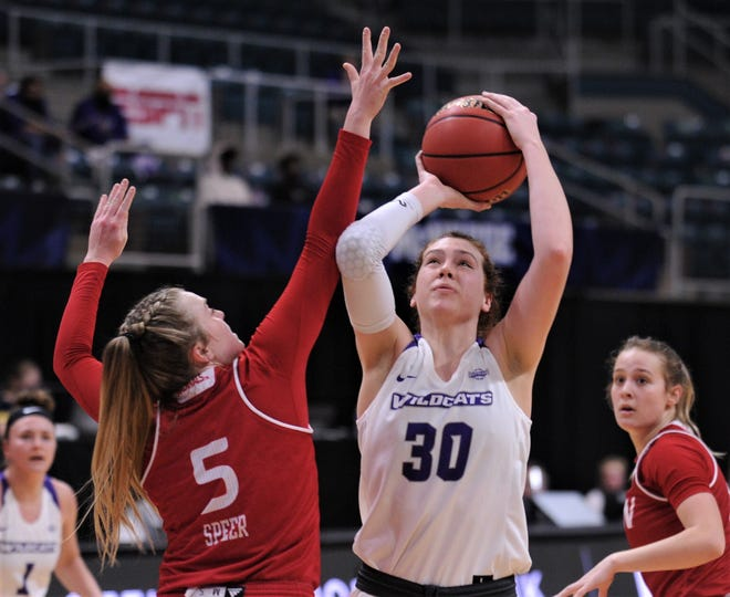 ACU's Anna McLeod (30) shoots over Incarnate Word's Destiny Jenkins. McLeod had a game-high 28 points and 10 rebounds as ACU beat the Cardinals 81-70 in the first round of the Southland Conference women's tournament Wednesday, March 10, 2021 at the Merrell Center in Katy.