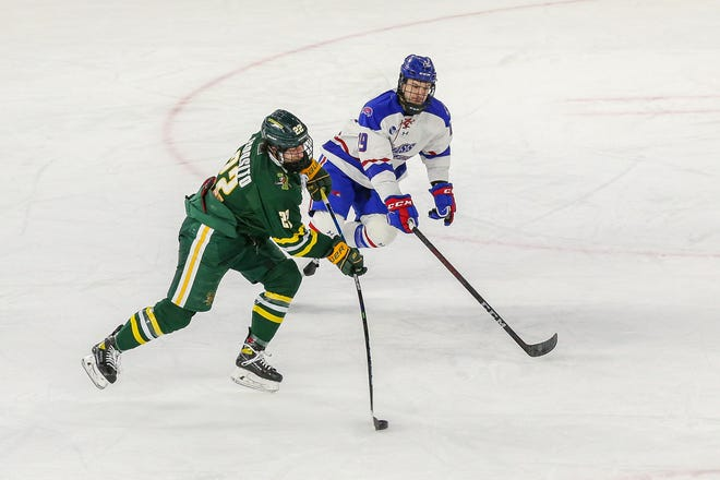 Vermont's Alex Esposito fires a shot during Wednesday's Hockey East first-round playoff game vs. UMass Lowell. The Catamounts lost 5-3.