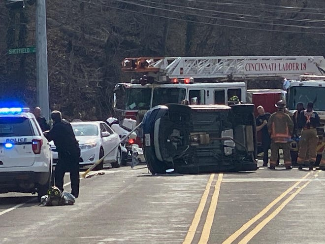 Cincinnati firefighters respond to a crash Wednesday on Linwood Avenue that forced the East Side street's closure.