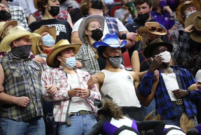 Waukee student fans cheer on the Warriors against Pleasant Valley in their Class 4A game on Wednesday, March 10, 2021, during the Iowa high school boys state basketball tournament at Wells Fargo Arena in Des Moines.