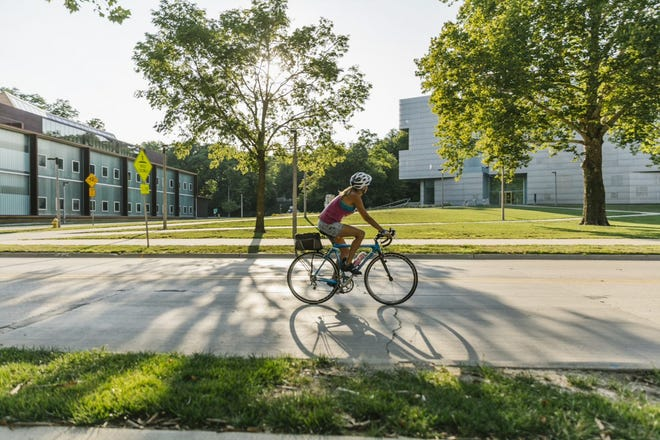 Cyclists enjoy gently rolling hills and advanced climbs on Iowa City's paved roads and trails.