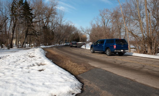 A pickup drives down Harbor Drive in the City of Oconto. The roadway will be reconstructed in a project set to start this spring.