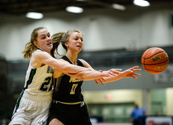 Glacier's Ellie Keller attempts to knock the ball away from Billings West's Layla Baumann as she makes a pass during the Class AA State Basketball Tournament quarterfinals in Great Falls.