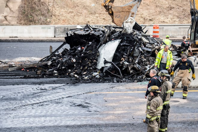 The remaining parts of the 18 wheeler that caught on fire is moved to the median of I-40, to allow traffic to pass by. Two 18 wheelers heading Eastbound on I-40 were in a traffic accident, causing one to catch on fire, at around 4:30am on Wednesday, March 10, 2021 in Jackson, Tenn. Traffic was at a stand still since the moment of the accident.