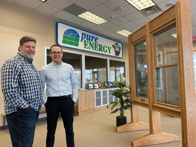 From left, Matt Masters and Adrian Beaver show off their new showroom at a new 39,000-square-foot headquarters for their high-efficiency window company Pure Energy Window Company in Brighton Township, Tuesday, Feb. 9, 2021.