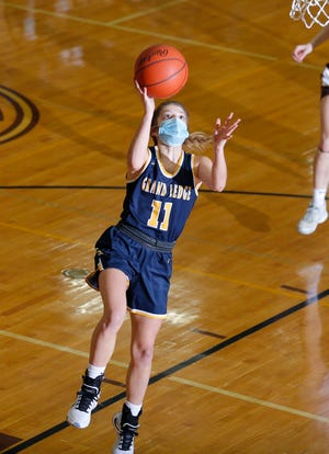 Grand Ledge's Morgan Hetherington gets a fast-break layup against Holt, Tuesday, March 9, 2021, in Holt, Mich. Grand Ledge won 62-47.