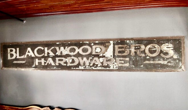A sign from a former business at 3001 S. Kinnickinnic Ave. now hangs in the latest business to call the building home: Blackwood Bros. Restaurant and Social Club, due to open by May 1.