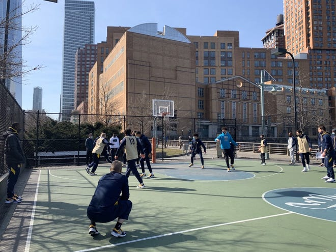 Marquette goes through its walkthrough outside in New York City on Wednesday.