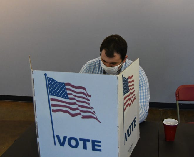Dylan Connolly votes at the Twin Lakes Plaza shopping center on Tuesday evening in Mountain Home's special election.