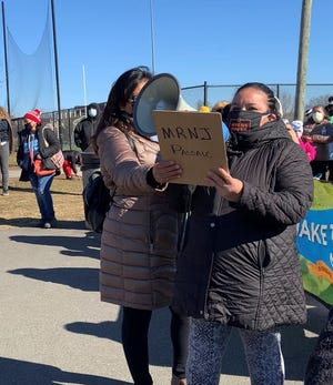 """Maria Sandoval of Passaic speaks at """"Excluded Women March"""" in Passaic on March 7, 2021."""