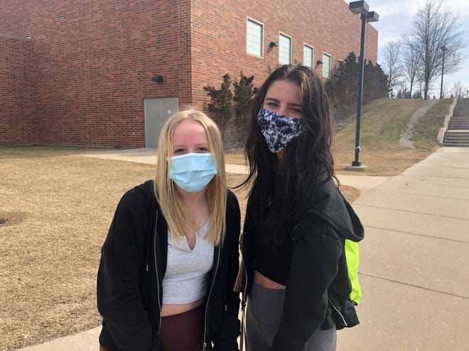 """Emily Woodyard (left) and Jessica Link, both South Lyon East juniors, say the past year taught them to appreciate the little things in life, some of which were big things all along, but which they previously took for granted like being in the classroom or seeing their grandparents. Jessica said the experience, which included contracting COVID-19 herself, """"has made me a stronger person mentally."""""""