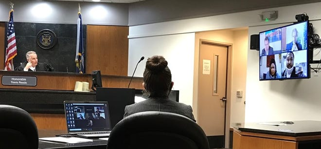 District Judge Travis Reeds modified Anthony Marshall Porter's bond, allowing him to stay with his mother on a tether, on Wednesday, March 10, 2021. Porter appears in the bottom right corner of the judge's live-stream screen.