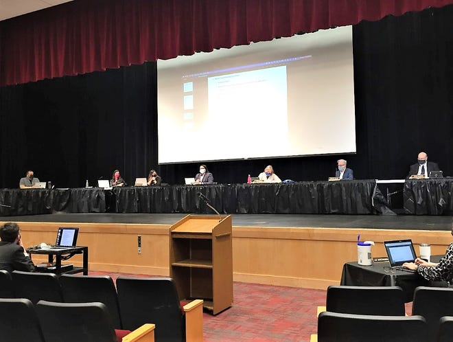 One week after the resignation of trustee Leonardo Savage, the Plymouth-Canton Schools Board of Education met March 9 in the Canton High School auditorium.