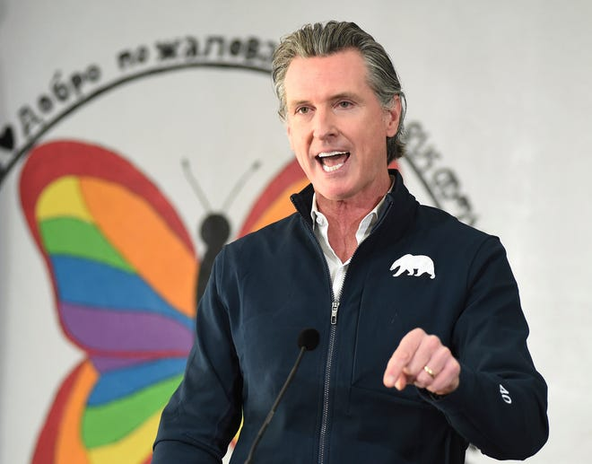 FILE - In this Feb. 26, 2021, file photo, California Gov. Gavin Newsom speaks during a press conference, after visiting a COVID-19 vaccination clinic for farmworkers at the Dr. Sharon Stanley-Rea Community Center in Fresno, Calif.  Gov. Newsom is set to give perhaps the most important speech of his political life Tuesday, March 9, and he's spent weeks laying the groundwork for an upbeat address aimed at nearly 40 million people exhausted by a year of coronavirus restrictions. (John Walker/The Fresno Bee via AP, File)
