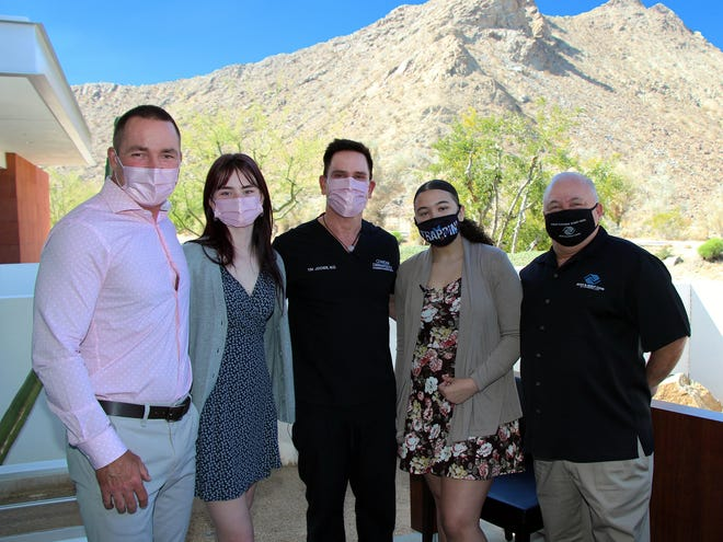 Lee Erwin, executive director, Contour Dermatology & Cosmetic Surgery Center poses with daughter Ashley Erwin-Jochen; Dr. Timothy Jochen; Kayla Sachs, Boys and Girls Club of Cathedral City Youth of the Year, and Scott Robinson, CEO, Boys and Girls Club of Cathedral City.