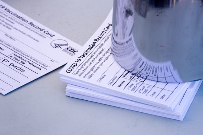 Vaccination cards are pictured on March 10, 2021, at Pleasant Pediatrics in Glendale.