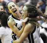 Andrea Hoover, left, and Suzie Noyes, embrace following an LVC women's basketball team NCAA Tournament  victory in 2011.