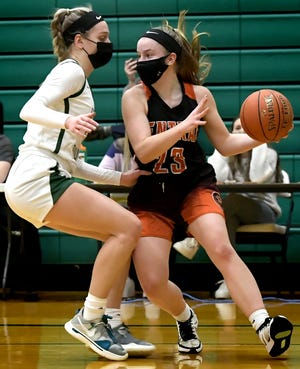 Central York's Sarah Berman drives in the key with Central Dauphin's Izzy Vogel defending in a District 3 Class 6-A girls' basketball semifinal in Harrisburg Tuesday, March 9, 2021. Central York won 32-26. Bill Kalina photo